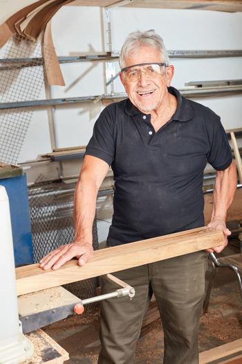 Portrait of senior carpenter at workshop