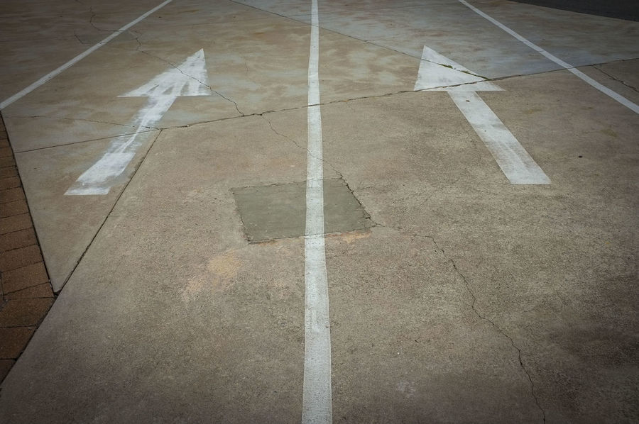 Directional arrows painted on the ground. Direction Directional Directional Arrows Directions No People Outdoors