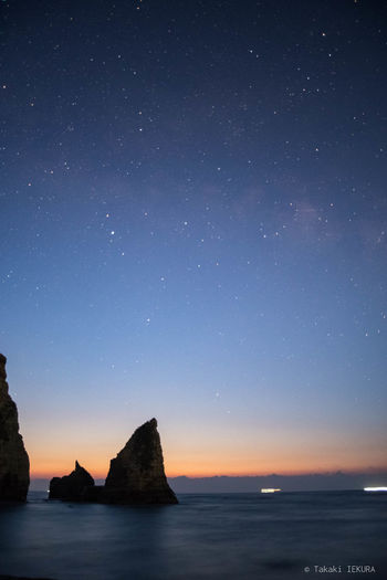 Astronomy Beauty In Nature Blue Dawn Nature No People Outdoors Rock - Object Sea Sky Star - Space Tranquil Scene Tranquility