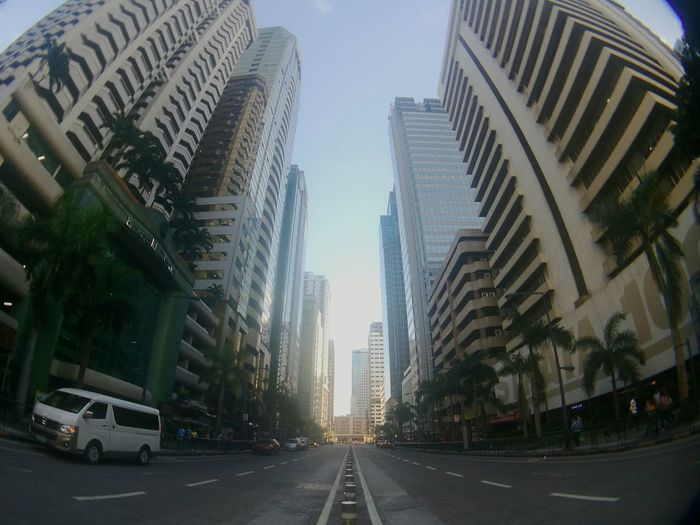 Light at the end of Emerald. Road City Architecture Skyscraper Outdoors Sky Day No People Eyeem Philippines Pedestrian Philippines Wide Angle Buildings