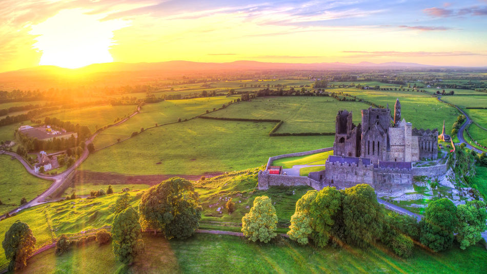 Rock of Cashel at sunset time, Co Tipperary, Ireland. Castle Ireland Rock Of Cashel Ancient Ancient Civilization Architecture Beauty In Nature Building Exterior Built Structure Day Fragility Grass History Landscape Nature No People Outdoors Scenics Sky Sunlight Sunset Tranquil Scene Tranquility Tree