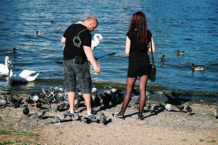 Dancing with Pigeons by the Riverside // Two People Water Real People Togetherness Standing Sea Day Leisure Activity Vacations Outdoors Nature Full Length Couple People Adult Adults Only FUJIFILM X-T10 F/7.2 Iso 200 XF18-55mmF2.8-4 R LM OIS via Fotofall
