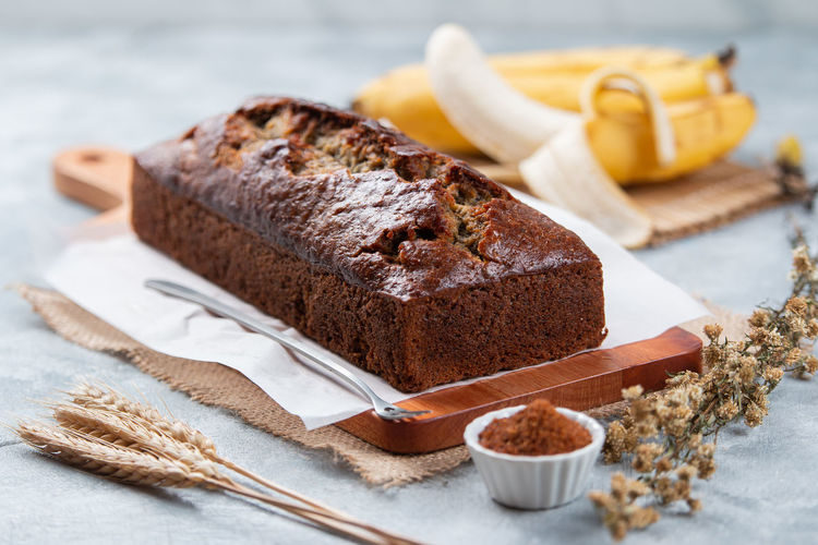 Close-up of cake on table, a homemade banana cake on the wooden tray