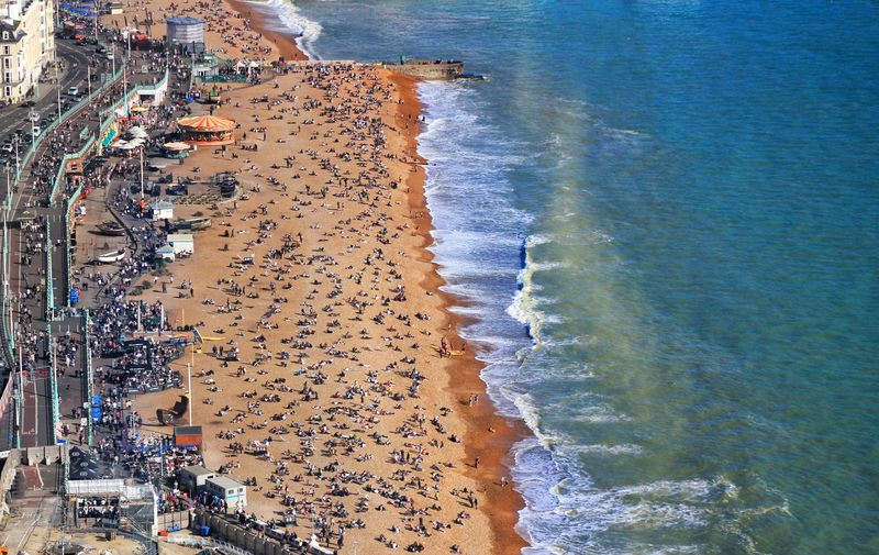 Brighton Beach, UK Beach Sea Water Shore Wave High Angle View Large Group Of People Beauty In Nature Sand Horizon Over Water Nature Real People Travel Destinations Coastline Outdoors Scenics Nautical Vessel Day Vacations Architecture United Kingdom England Brighton I360 Summer