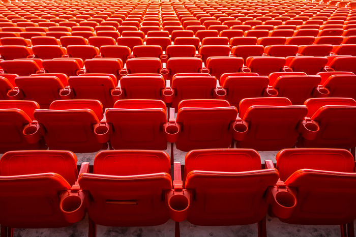 Absence Abundance Arts Culture And Entertainment Auditorium Background Backgrounds Bleachers Chair Empty Full Frame In A Row Indoors  Large Group Of Objects No People Red Repetition Seat Side By Side Stadium
