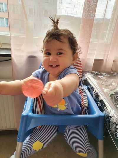 Portrait of cute baby girl smiling at home