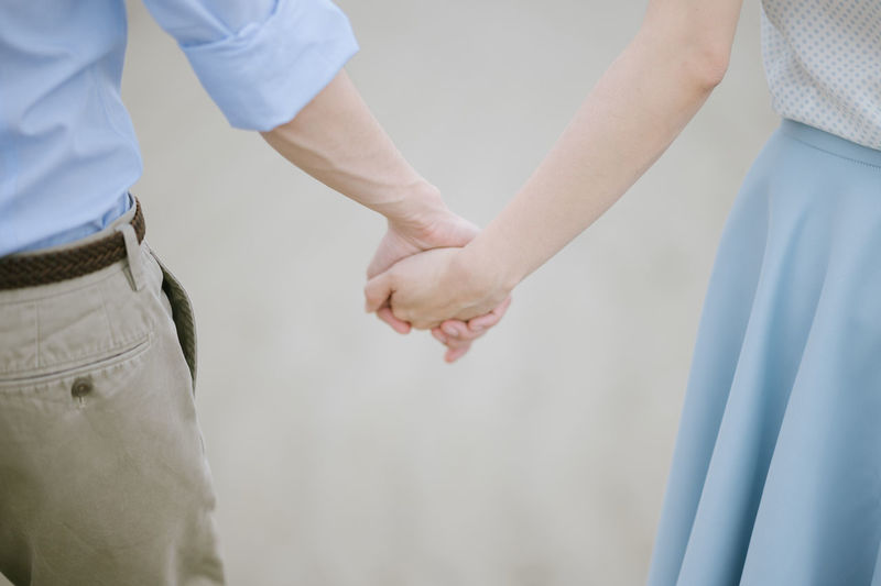 Two People Holding Hands Midsection Togetherness Love Positive Emotion Men Adult Women Bonding Real People Emotion Couple - Relationship People Standing Hand Human Hand Heterosexual Couple Care Holding Together Forever Togetherforever Love Valentine Wedding Dress