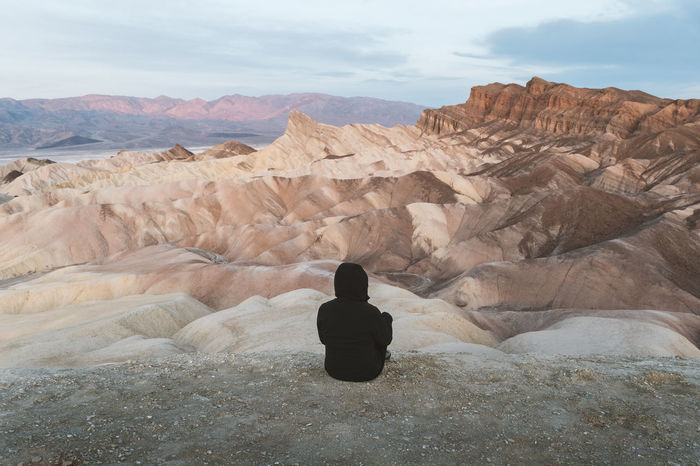 Woman in black sitting and enjoying the pastel sunrise at Zabriskie Point, California Amargosa Range California Death Valley Death Valley National Park Mountain View One Person Only Pastel Sky Sky And Clouds Zabriskie Point Arid Climate Mountain Mountain Range Mountains And Sky One Person Outdoors Personal Perspective Real People Remote Roadtrip Rock Rock - Object Sky Porn Sunrise Sunrise And Clouds Woman Sitting Alone A New Beginning