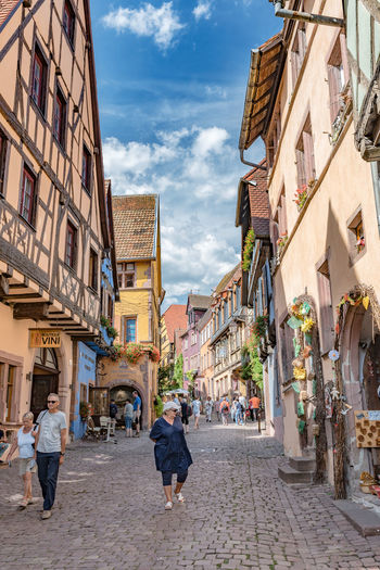 Alsace France Riquewihr Village Travel Destinations Travel Photography Building Exterior Architecture City Built Structure Streetphotography Cloud - Sky Outdoors Rear View Landscape_Collection Landscape_photography Cityscape Lifestyles People Watching Aroundtheworld