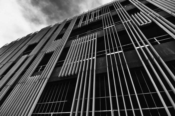 Architecture Built Structure Low Angle View Modern Outdoors No People Building Exterior Carpark Black And White Day Sky Skyscraper