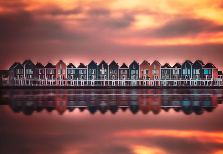 Rainbow colored houses on Rietplas, Houten It's Spring Sale in the Webshop and get a massive 60% Discount on ALL my Lightroom - Adobe Camera RAW Profiles/Presets Collections ! !! **** Use The discount code 500PX www.remoscarfo.com Architecture Cloud - Sky Sky Building Exterior Water Built Structure Sunset Building No People Orange Color Nature House Waterfront Reflection Residential District Outdoors Sea Beauty In Nature Side By Side Row House Remo SCarfo Dutch Holland Houten Post Processing