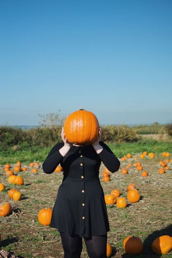 Pumpkin Food And Drink Food Orange Color Sky Field Nature Standing Plant Healthy Eating Clear Sky Halloween One Person Land Three Quarter Length Day Real People Leisure Activity Fruit Orange