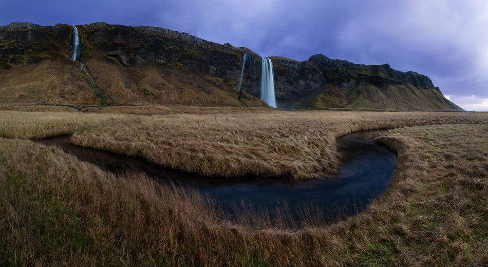 Seljalandsfoss Panorama Beauty In Nature Cloud - Sky Day Grass Iceland Landscape Long Exposure Mountain Mountain Range Nature No People Outdoors Panorama View Rural Scene Scenics Seljalandsfoss SeljalandsfossWaterfall Sky Tranquil Scene Tranquility Water Waterfall Waterfalls