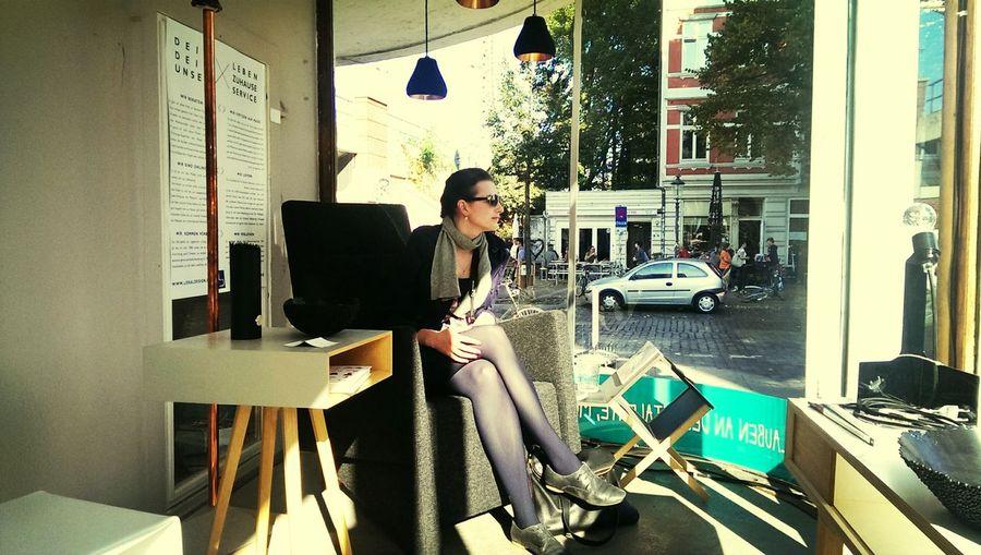 Sitting in a Shop Window at LokalDesign - coolest Interiordesign in Hamburg