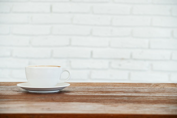 single coffee cup on wooden table Close-up Coffee - Drink Coffee Cup Day Drink Food And Drink Freshness Indoors  No People Refreshment Saucer Table Wood - Material
