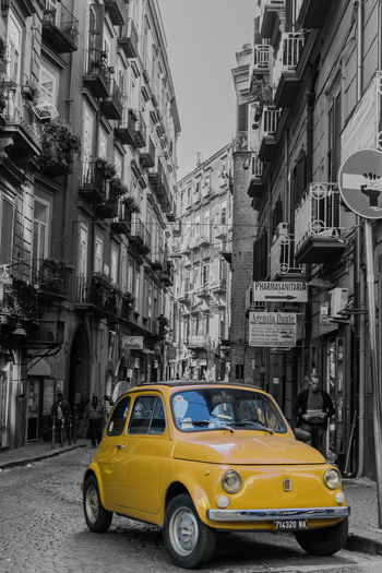 Composition Signs Architecture Building Building Exterior Built Structure Car City City Life City Street Color Day Italy Land Vehicle Mode Of Transportation Monochrome Motor Vehicle Outdoors Portrait Residential District Road Street Urban Skyline Yellow The Traveler - 2018 EyeEm Awards The Street Photographer - 2018 EyeEm Awards