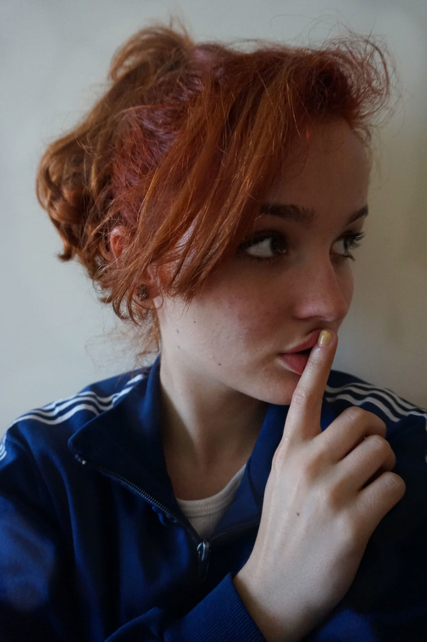 young adult, one person, real people, redhead, young women, lifestyles, tensed, headshot, indoors, beautiful woman, close-up, portrait, day