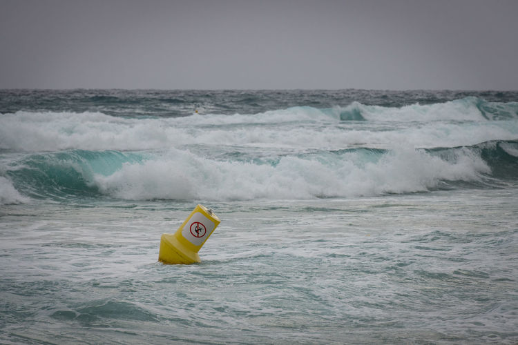 Stormy Mediterranean Sea Sport Water Wave Motion Waterfront Aquatic Sport Surfing Yellow Beauty In Nature Sports Equipment Day Nature Sky Horizon Over Water Outdoors People Horizon Floating On Water Power In Nature Inflatable  Flowing Water Storm