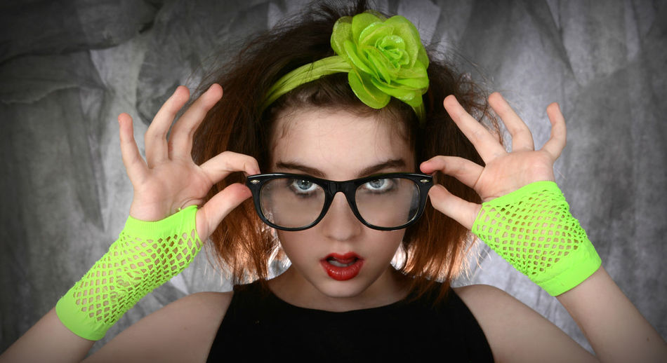 Close-up portrait of confident teenage girl wearing eyeglasses