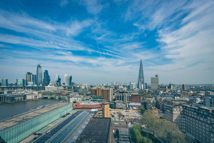 View of London from the roof of the Tate Modern, April 2019. Building Exterior Built Structure Architecture City Sky Cityscape Building Office Building Exterior Cloud - Sky Skyscraper Tower Tall - High Urban Skyline Nature Modern Travel Destinations No People Residential District High Angle View Outdoors Financial District  Spire  River Thames London The Shard Walkie Talkie Building Tate Modern