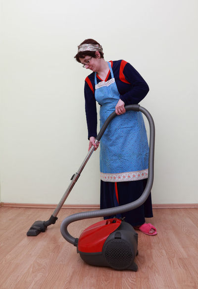 Woman using the vacuum cleaner. EyeEm Best Shots Housewife Housework Act Active Adult Casual Clothing Cleaning Cleaning Equipment Floor Home Interior Housewife Life Housework Indoors  Lifestyles Occupation One Person People Real People