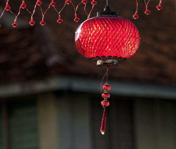 Low Angle View Of Lantern Hanging At Doorway