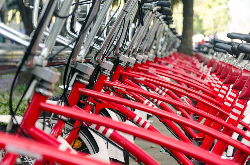 Red bicycles in parking lot