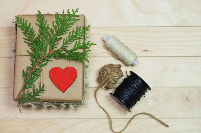 Gift box made of kraft paper, tied with lace. A wooden red heart and dry twigs. St. Valentine's Day, Christmas and New Year. Box Braids Love Box - Container Heart ❤ Valentine's Day - Holiday