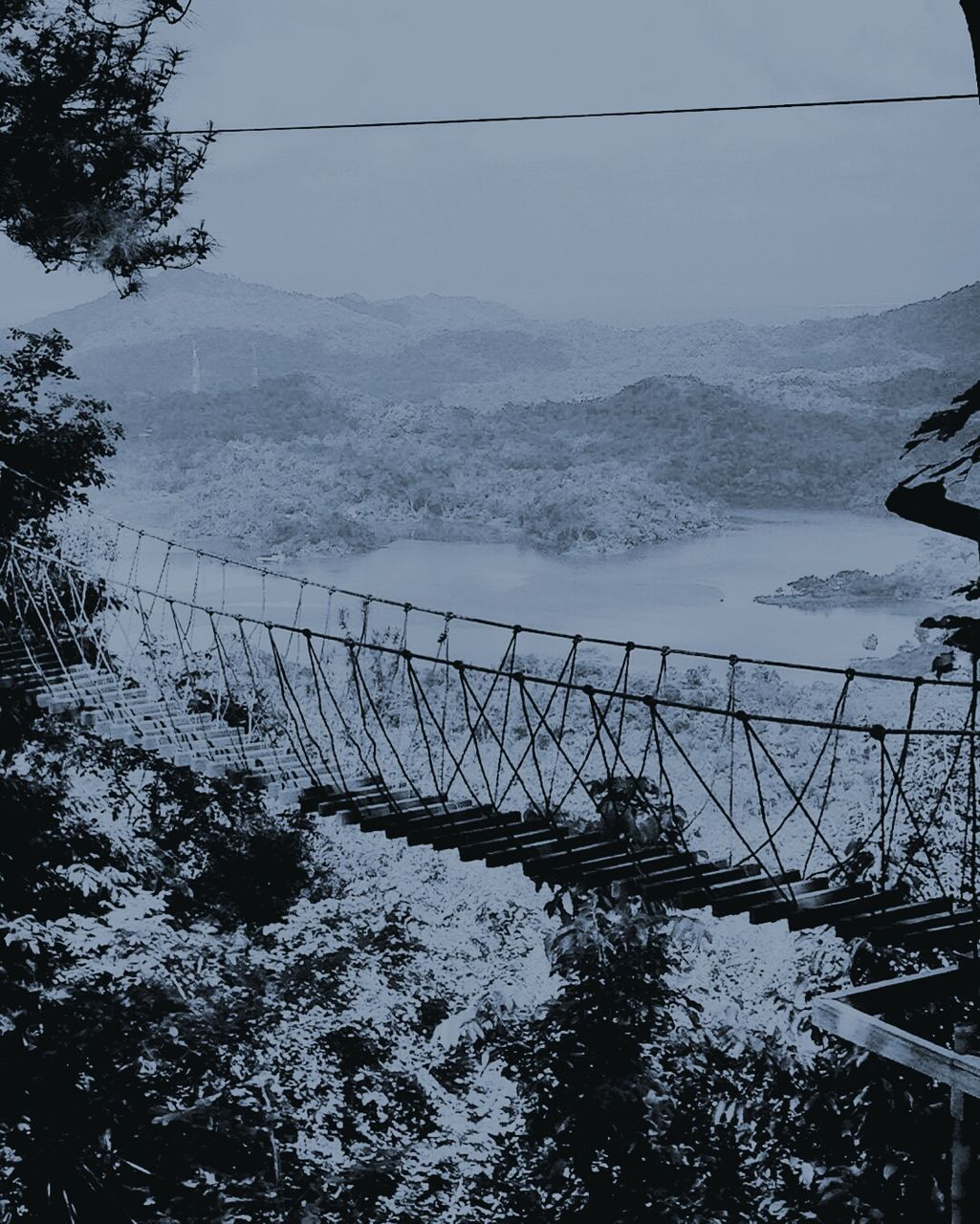 nature, mountain, snow, tree, winter, cold temperature, railing, day, no people, scenics, outdoors, beauty in nature, tranquil scene, tranquility, landscape, cable, water, mountain range, sky