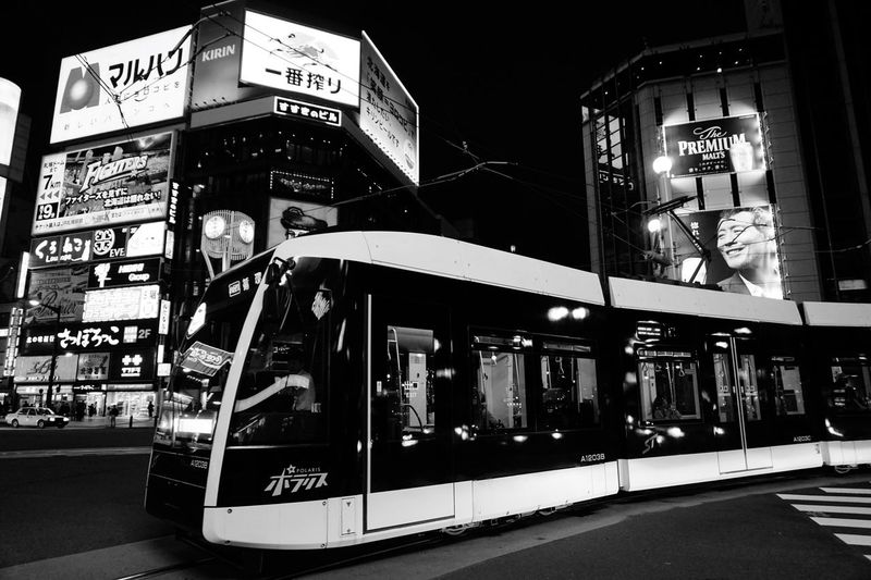 Street Streetphoto_bw Black & White Night Lights Tram Text Communication Built Structure Night Architecture City Illuminated Building Exterior Sign