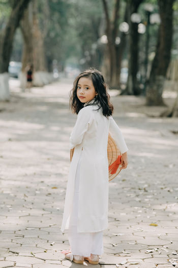 Vietnamese baby girl in traditional long dress with hat. HA NOI - VIET NAM. DATE 22/05/2018 Day Focus On Foreground One Person Real People Women