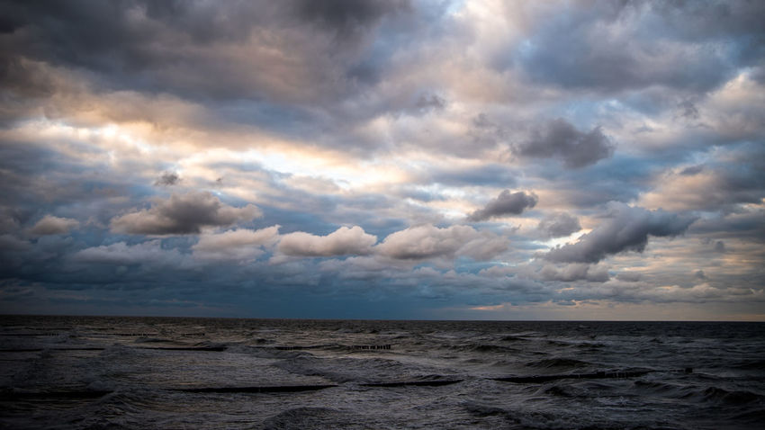 Cloud - Sky Sand Beach Outdoors Sky Nature No People Beauty In Nature Dramatic Sky Scenics Storm Cloud Day Water Ocean Ostsee 😎 Ostsee Harsh Weather Horizon Over Water Nature Cloudscape Wave Sea Kühlungsborn Ocean View Ocean Waves