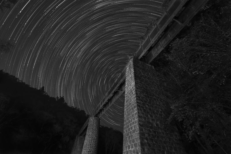 Low angle view of bridge at night