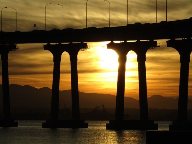 California Coast California California USA Sunset Silhouette Sky Bridge - Man Made Structure Water Connection Built Structure River Sun Cloud - Sky Nature No People Architecture Travel Destinations Sunlight Mountain Scenics Outdoors Beauty In Nature Day