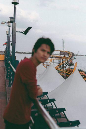 Man in boat against sea against sky