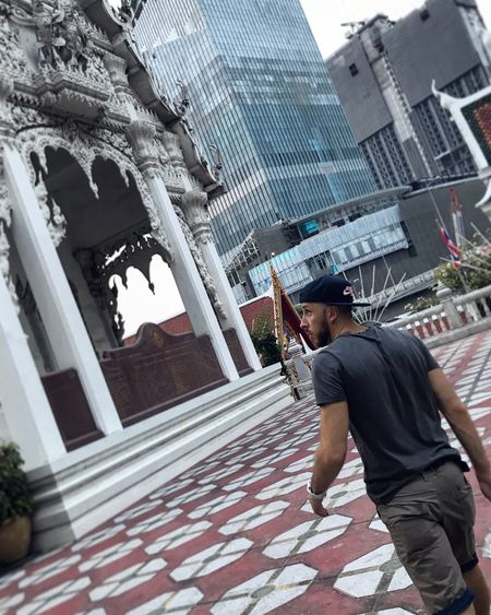 Man standing by buildings in city