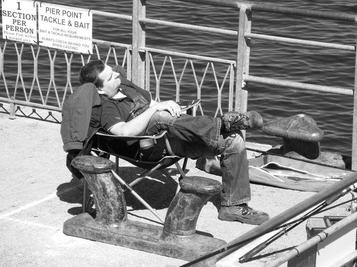Angler Asleep Day Fisherman Fishing Leisure Activity Outdoors Seaside Seaside Pier Telling Stories Differently Up Close Street Photography Alternative Fitness Night Night, Sleep Tight Man Asleep