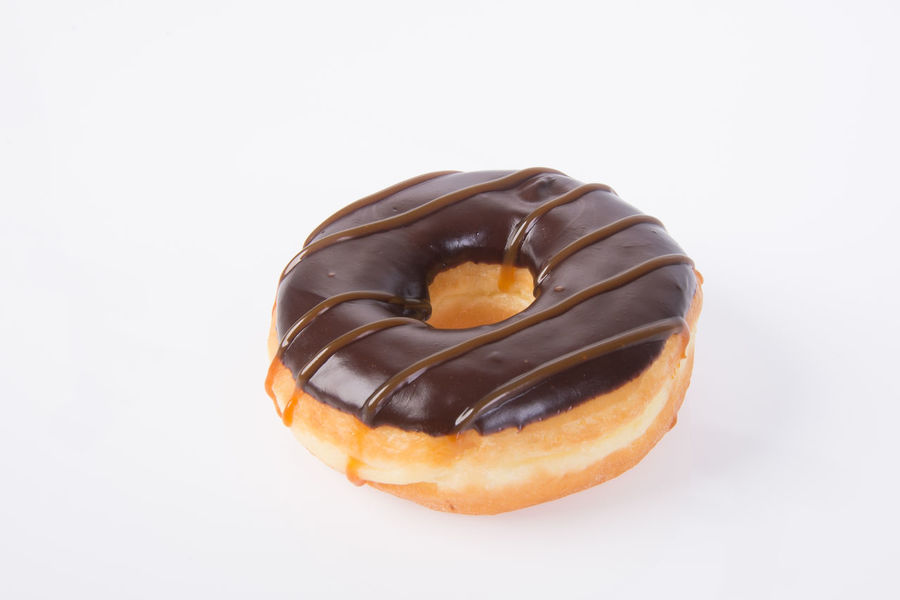 Chocolate Chocolate Sauce Close-up Dessert Dessert Topping Donut Food Food And Drink Freshness Glazed Food Indulgence No People Ready-to-eat Studio Shot Sweet Food Temptation Unhealthy Eating White Background