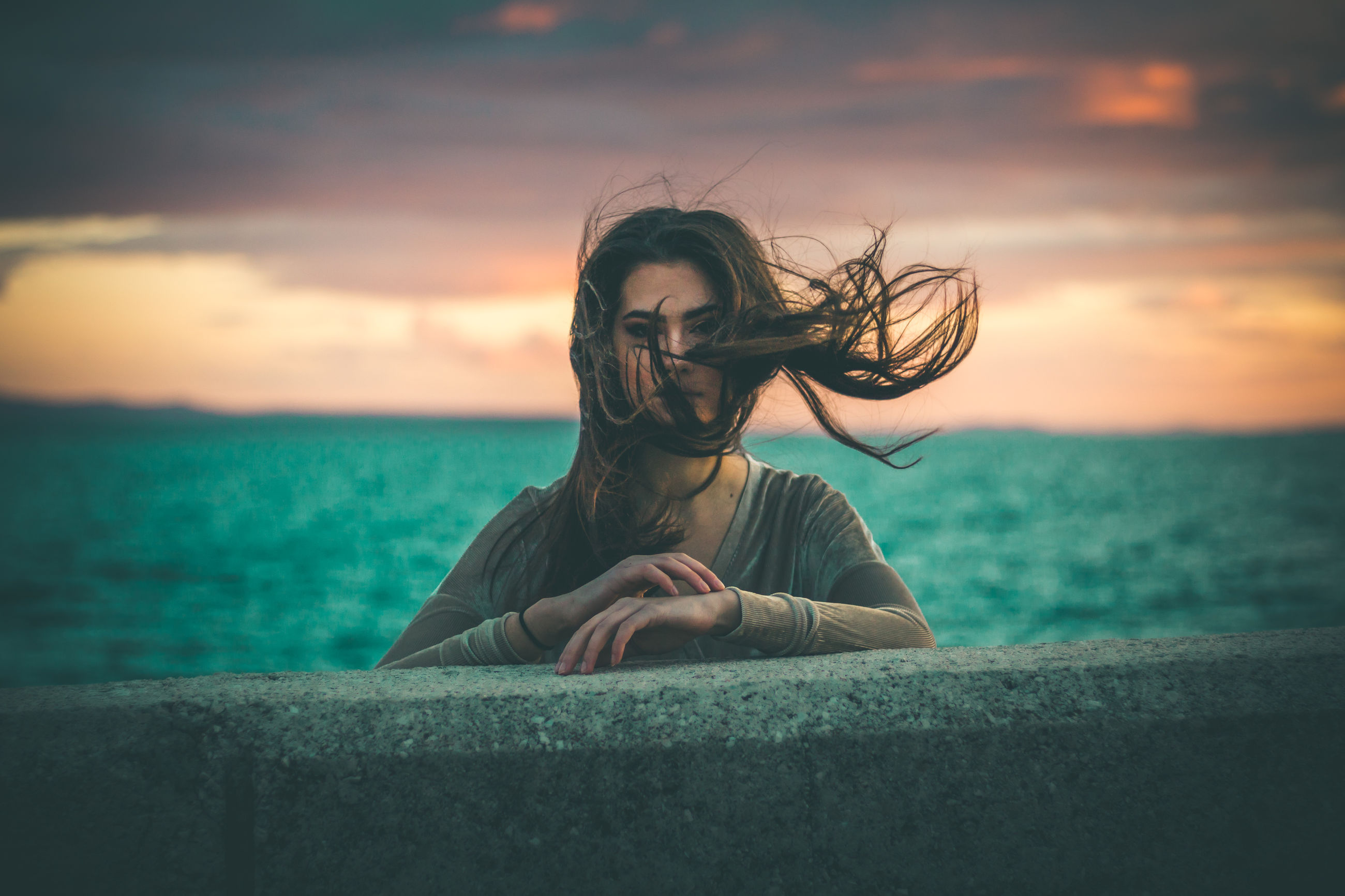 water, sky, sea, one person, real people, horizon over water, nature, long hair, horizon, cloud - sky, leisure activity, land, hair, young adult, lifestyles, sunset, hairstyle, beauty in nature, tousled hair, outdoors, wind