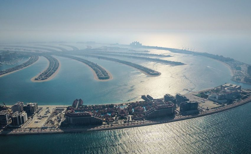 dubai drone above palm Dubai Palm Jumeirah Aerial View Architecture Beauty In Nature Building Exterior Built Structure City Cityscape Day Landscape Nature Nautical Vessel No People Outdoors Scenics Sea Sky Transportation Travel Destinations Water