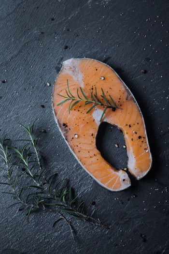Fresh Salmon slice with rosemary. Black Stone Dinner Food And Drink Fresh Fish Rosemary Close-up Fish Fish Dish Flat Lay Food Food Decoration Food Ingredients Food Photography Food Preparation Fresh Food Healthy Eating Healthy Food Restaurant Salmon Salmon - Seafood Salmon Slice Steak Stone Buildings Stone Material Top View