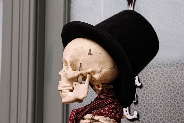 Dapper in the Corn Exchange. Architecture Art And Craft Built Structure Close-up Clothing Craft Cravat Creativity Dapperman Day Hat Headshot Human Face Human Representation Lifestyles Male Likeness One Person Real People Representation Sculpture Skull Face Statue Wall - Building Feature