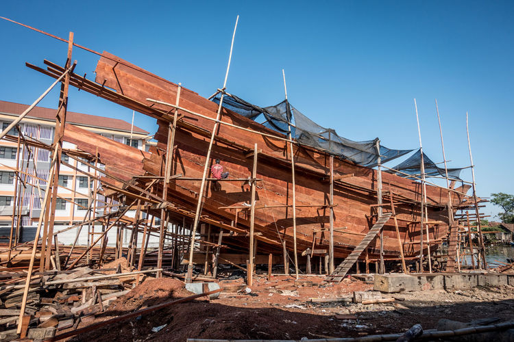 Wooden ship under construction in Indonesia Built Structure Clear Sky Construction Incomplete Industry Ship Ship Building Wooden Boat