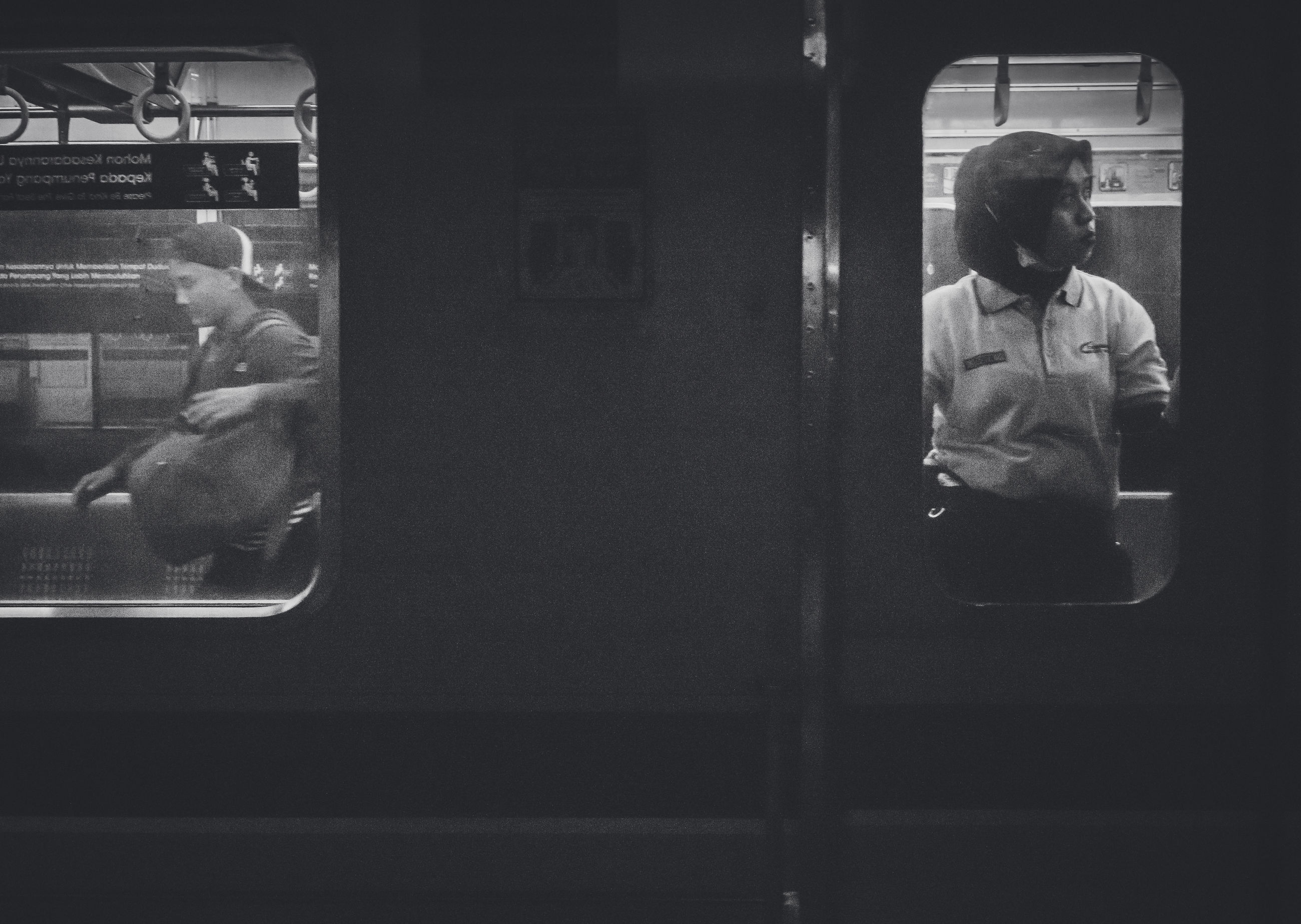 public transportation, real people, mode of transportation, men, rail transportation, transportation, one person, train, window, lifestyles, train - vehicle, rear view, land vehicle, sitting, leisure activity, vehicle interior, passenger, travel, transparent, outdoors, subway train, waiting