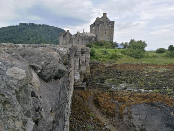 Eilean Donan Castle Eilean Donan Scotland Scottish Highlands Scottish Scenery Scott Monument History Castle Medieval Old Ruin Architecture Ancient Fort Building Exterior Built Structure Outdoors Travel Destinations Day Tree No People Ancient Civilization Sky