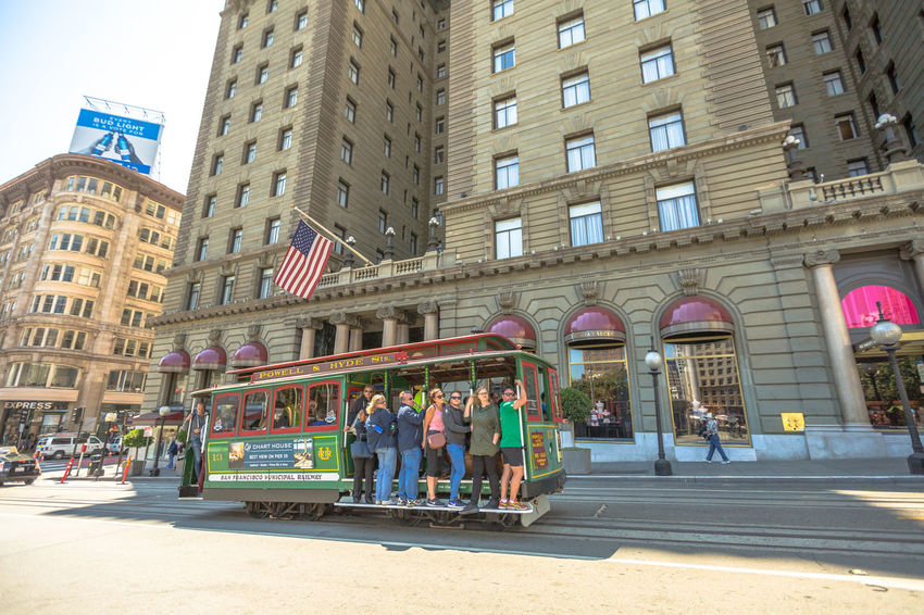 San Francisco, CA, United States - August 17, 2016: crowds of tourists in the popular Union Square, the central square of San Francisco on Market Street, known as the place shopping and luxury hotels. San Francisco, California, United States - August 17, 2016: the Big Bus, Hop On Hop Off, Sightseeing Tour, the popular double-decker bus carrying tourists, standing in Union Square, during a day tour. Cable Car California Market SF San Francisco Square Union Union Square SF United States Adult Adults Only Architecture Building Exterior Built Structure City Day Full Length Market Street San Francisco Market Street Medium Group Of People Men Outdoors People Real People Street Union Square  Unionsquare Women