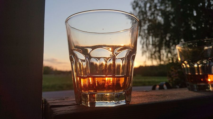 Close-up of glass whith whiskey on table