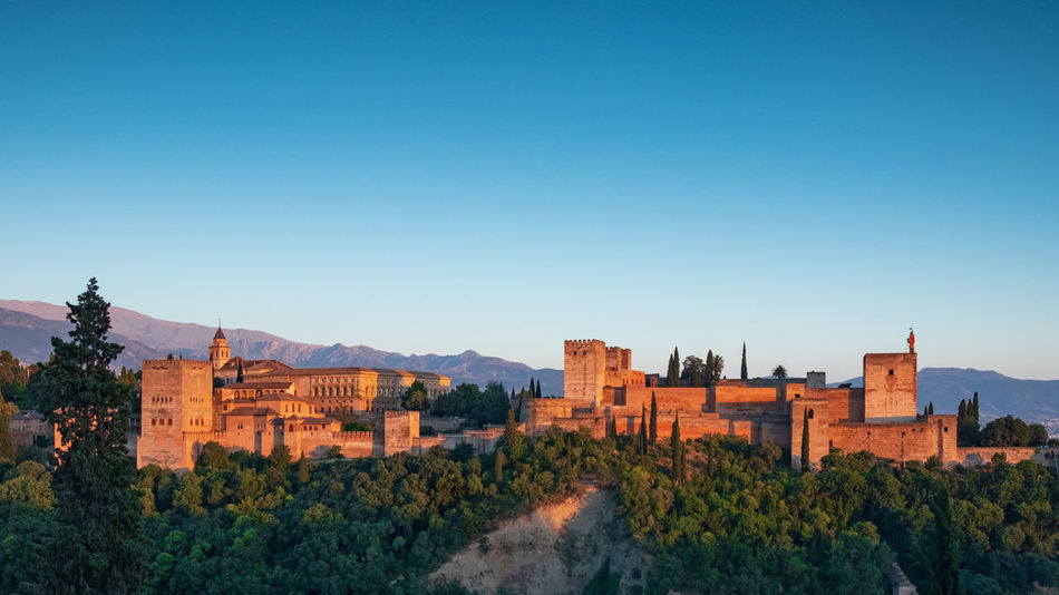 Alhambra Alhambra De Granada  Alhambra (Granada) Granada Granada, Spain Ancient Ancient Civilization Ancient Architecture Ancient History Travel Travel Destinations Travel Photography Built Structure Architecture Sky Plant Building Exterior Tree Clear Sky Nature Building Day No People Outdoors Sunset #sun #clouds #skylovers #sky #nature #beautifulinnature #naturalbeauty #photography #landscape