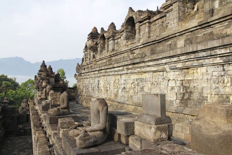Borobudur Temple with the Buddha statue during sunrise, Yogyakarta, Indonesia INDONESIA Java Sunlight Yogyakarta Ancient Ancient Architecture Ancient Civilization Architecture Bas-relief Borobudur Buddha Statue Buddhism Built Structure History No People Old Outdoors Place Of Worship Religion Rock - Object Sculpture Sky Spirituality Stone Material Stone Wall