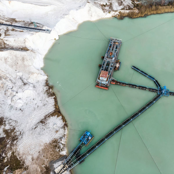 Aerial photograph of a large suction dredger in a wet mining process for quartzite snow-white sand, made with drone Drone Landscape Machine Quartz Suction Aerial Architecture Building Exterior Built Structure Day Dredger Environment Excavation High Angle View Mining Mode Of Transport Nature Nautical Vessel No People Outdoors Sea Swim Transportation Water Waterfront White